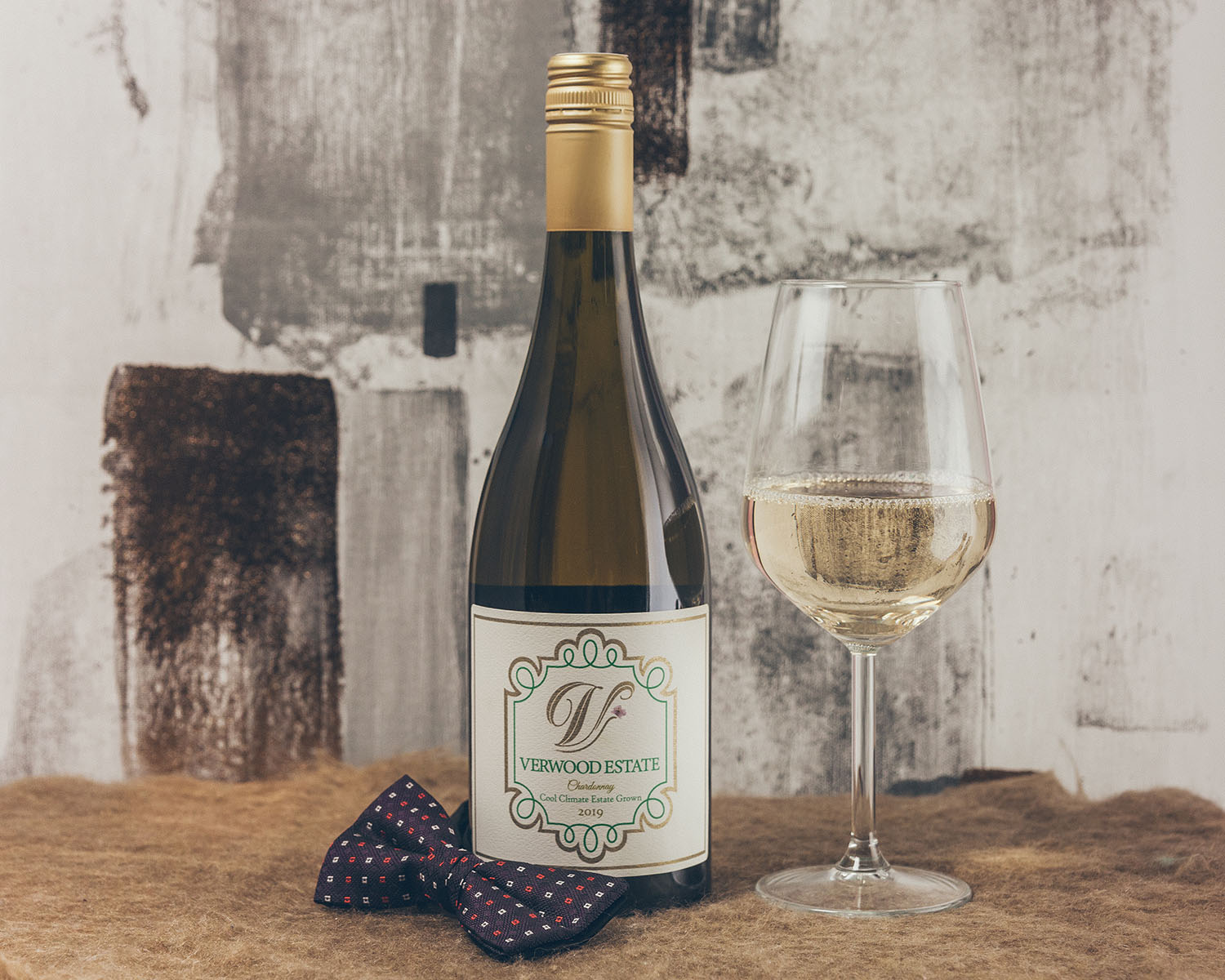 Verwood Estate Wines Chardonnay in a glass with a bow tie for Father's Day