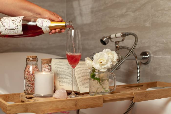 Pouring a glass of Verwood Estate Wines Shiraz Rose 2019 in a luxurious bath